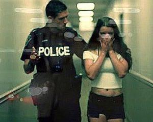 uniformed police officer escorting a sex trafficking victim