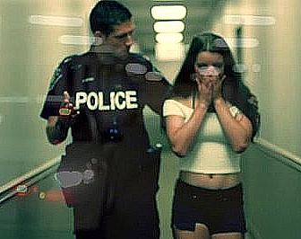 uniformed police officer escorting a sex trafficking victim