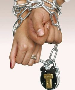 hands of a man and woman bound by a locked chain
